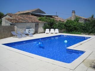 Swimming pool at les Hiboux holiday gite